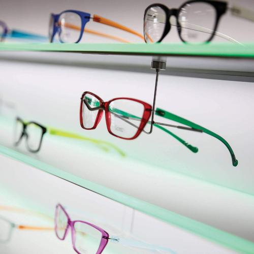 Magnetic wall eyewear shelf with white and colored LED lighting.