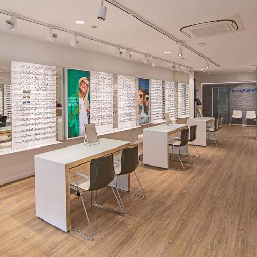 Clean and functional optical shop design for a German optometrist.