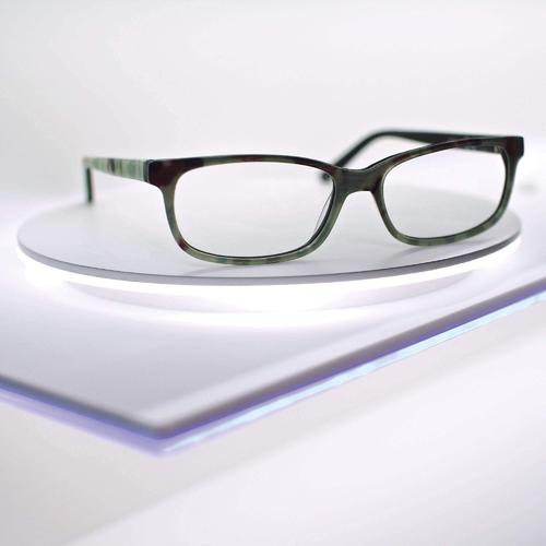 Panorama - rotatable acrylic wall eyeglasses shelf. Integrated LED lighting.